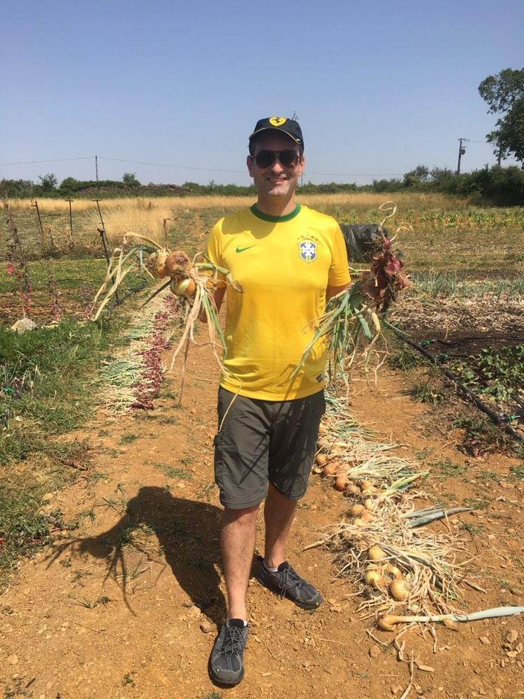 Marcelo picking vegetables at the Bonnevaux Organic Farm